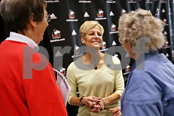 Beck Diefenbach  -  bdiefenbach@daily-chronicle.com<br /> <br /> New Northern Illinois women's head coach Kathi Bennett (center) talks to Mary Bell (right) and Lou Jean Moyer following her introduction at the NIU Convocation Center in DeKalb, Ill., on Tuesday May 18, 2010.