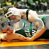 Rob Winner – rwinner@daily-chronicle.com<br /> <br /> DeKalb's Dalton Watie (top) takes Glenbard West's D.J. Terdy to the mat during their 160-pound quarterfinal match at the Don Flavin Tournament at DeKalb on Wednesday, Dec. 29, 2010.<br /> <br /> **Watie of DK won