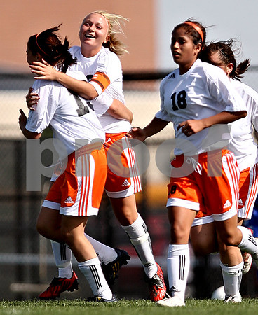 Beck Diefenbach  -  bdiefenbach@daily-chronicle.com<br /> <br /> DeKalb's Audrey Mascal (19, left) and Kay Smith (13 center) celebrate after a goal by Lizzy Conejo (18) during the first half of the game against Burlington Central at Rochelle Township High School in Rochelle, Ill., on Tuesday May 18, 2010. DeKalb defeated Burlington Central 4 to 2.