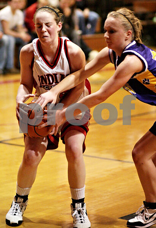 Beck Diefenbach  -  bdiefenbach@daily-chronicle.com<br /> <br /> Indian Creek's Lauren Anderson (33) tries to keep the ball away from Paw Paw's Casey Crawford (12) during the first quarter of the IHSA Class 1A Regional game at Indian Creek High School in Shabbona, Ill., on Monday  Feb. 8, 2010.