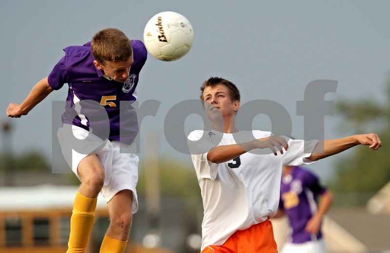 Beck Diefenbach - bdiefenbach@daily-chronicle.com<br /> <br /> DeKalb's Zack Wallin (3, right) watches as Hononegah's Jack Harp (5) heads the ball during the second half of the game at DeKalb High School in DeKalb, Ill., on Tuesday Aug. 24, 2010. DeKalb and Hononegah tied 1 to 1.