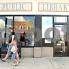 Rob Winner – rwinner@daily-chronicle.com<br /> <br /> After returning books and checking out new ones, Genoa residents Kim Siegwarth and her daughter Alahna, 4, leave the Genoa Public Library in Genoa, Ill. on Saturday August 14, 2010.