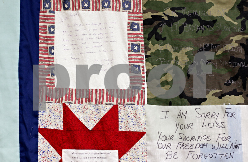 Beck Diefenbach  -  bdiefenbach@daily-chronicle.com<br /> <br /> A section of a quilt of valor on display at the Genoa Public Library in Genoa, Ill., on Monday Jan. 25, 2010. The quilt was made for 1st. Lt. Brian D. Slavenas, who was killed in Fallujah, Afghanistan.