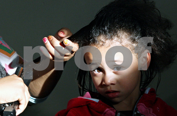 Rob Winner – rwinner@daily-chronicle.com<br /> <br /> Parish Ingram (left) dresses up 3-year-old Izzable Harrielle's hair at Hope Haven in DeKalb, Ill. on Thursday October 21, 2010.