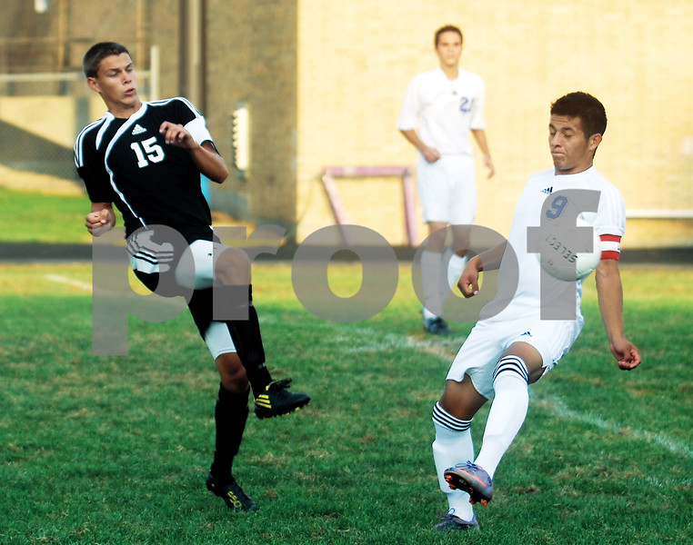 Sycamore's Josh Gulke competes with Dixon's Ceaser Gonzalez for the ball Tuesday evening at Dixon.