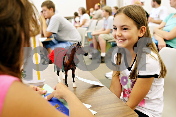 Rob Winner – rwinner@daily-chronicle.com<br /> <br /> Mary McCausland, 11 of the Genoa Prairie Gems, has her visual arts knitting project, which was a blanket for a toy horse, judged during the 4-H project show at the DeKalb County Farm Bureau in Sycamore, Ill. on Wednesday July 14, 2010.