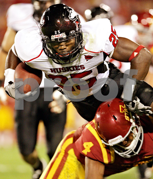 Beck Diefenbach  -  bdiefenbach@daily-chronicle.com<br /> <br /> Northern Illinois safety Tracy Wilson (25, tops) leaps over Iowa State quarterback Austen Arnaud (4) after making an interception during the second quarter of the game at Jack Trice Stadium on the campus of Iowa State University in Ames, Iowa, on Thursday Sept. 2, 2010. Iowa State defeated Northern Illinois 27 to 10.