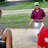 Beck Diefenbach - bdiefenbach@daily-chronicle.com<br /> <br /> Indian Creek girls golf coach Keith Haeg explains chipping out of a bunker to his team during practice at the Indian Oaks Golf Course in Shabbona, Ill., on Wednesday Aug. 18, 2010.