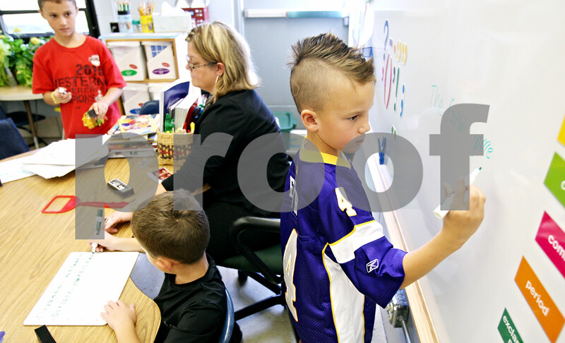 Rob Winner – rwinner@daily-chronicle.com<br /> <br /> Second grader Cade Miller, 7, uses a magnetic white board during a punctuation lesson on Wednesday September 29, 2010. The white board was purchased by donations made through a website called DonorsChoose.org.