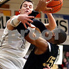 Rob Winner – rwinner@daily-chronicle.com<br /> Kaneland's Ryley Bailey (left) fouls Sycamore's Sam Ford during the first quarter of their game in Maple Park, Ill. on Saturday February 6, 2010.