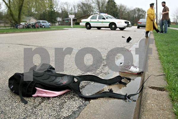 Rob Winner – rwinner@daily-chronicle.com<br /> <br /> A shoe and backpack lay on the side of Russell Road along with debris from a vehicle after a hit and run on Wednesday April 7, 2010 in DeKalb, Ill.