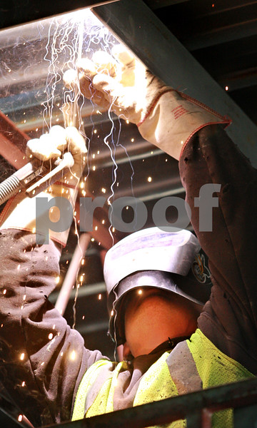 Kyle Bursaw - kbursaw@daily-chronicle.com<br /> <br /> Chris Cornell, of Area Erectors Inc, works on welding in supports on the ceiling of the Hy-Vee under construction at the corner of 23 and Oakland Dr in DeKalb on Nov. 2, 2010. The project is scheduled for completion in summer of 2011.