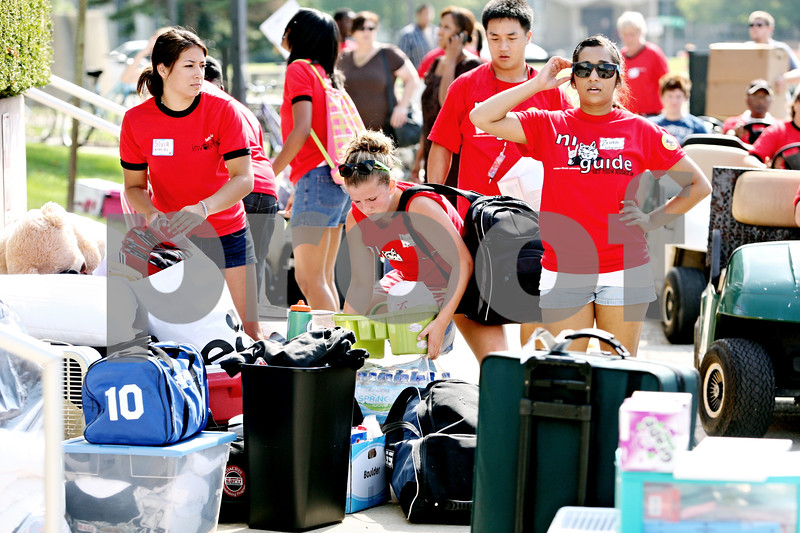 Rob Winner  -  rwinner@daily-chronicle.com<br /> <br /> (From left to right) Silvia Patino, Alicia Pfeiffer, and Zehra Hussain help incoming students move their belongings into South Grant Towers at Northern Illinois University in DeKalb, Ill. on Thursday August 19, 2010.