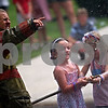 Beck Diefenbach  -  bdiefenbach@daily-chronicle.com<br /> <br /> From left, Logan Breese, 14, of Shabbona, guides Kaitlyn Frazier, 6, of Shabbona, and Lauren Jordal, 5, of Lee in the kiddie water fights during Fourth of July festivities in Shabbona, Ill., on Sunday.
