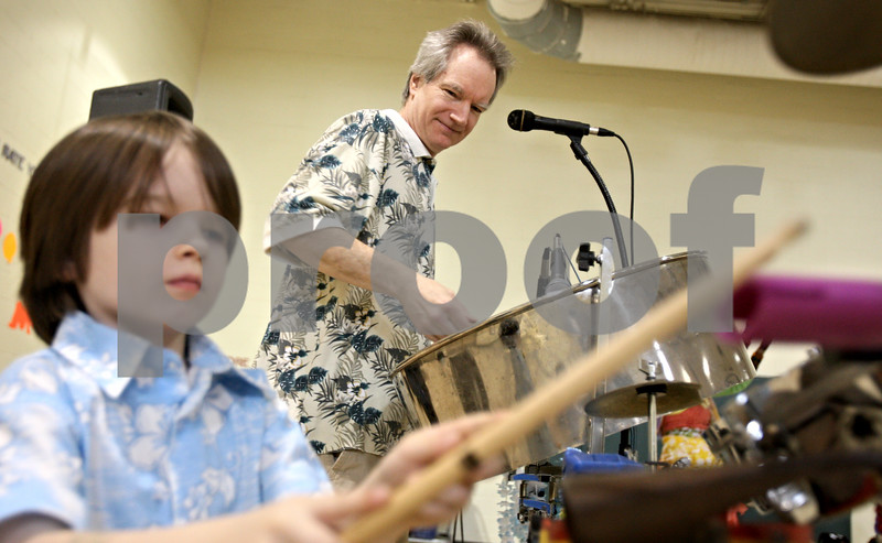 """Rob Winner – rwinner@daily-chronicle.com<br /> <br /> Tyler Donnelly (left), 5, and his father Todd Donnelly play the drums during an assembly at Gwendolyn Brooks Elementary School in DeKalb, Ill. on Tuesday March 30, 2010. Brooks Elementary is celebrating Fine Arts Week and their theme is """"Under the Sea."""""""