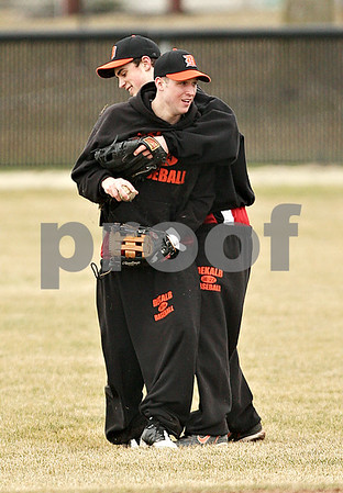 Beck Diefenbach  -  bdiefenbach@daily-chronicle.com<br /> <br /> DeKalb's Brian Sisler (left) embraces teammate Frank Petras after Petras dove for a catch during practice at DeKalb High School in DeKalb, Ill., on Monday March 15, 2010.