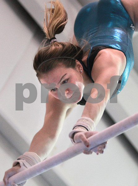 Kyle Bursaw – kbursaw@daily-chronicle.com<br /> <br /> Alyssa Lopez, a junior on the DeKalb gymnastics team, practices a routine on the uneven bars at Energym in Sycamore, Ill. on Tuesday, Dec. 21, 2010.