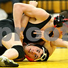 Rob Winner – rwinner@daily-chronicle.com<br /> Sycamore's Zack Spiewak (top) holds down DeKalb's Evan Jones during their 130-pound match in Sycamore, Ill. on Friday January 15, 2010. Sycamore defeated DeKalb 37-28.
