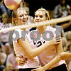 Rob Winner – rwinner@daily-chronicle.com<br /> <br /> DeKalb's MacKenzie Johnson (left) and Courtney Thomas celebrate a kill by Johnson during the first game against Kaneland in DeKalb, Ill. on Tuesday October 12, 2010. DeKalb went on to defeat Kaneland, 25-18 and 25-11.