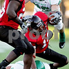 Rob Winner – rwinner@daily-chronicle.com<br /> <br /> Northern Illinois wide receiver Willie Clark is taken down from behind after a big gain during the first quarter against North Dakota in DeKalb, Ill. on Saturday September 11, 2010. Northern Illinois went on to defeat North Dakota, 23-17.