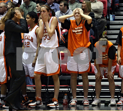 Beck Diefenbach  I  bdiefenbach@daily-chronicle.com<br /> <br /> The DeKalb basketball team reacts after they lose the game to Sycamore High School at the Northern Illinois University Convocation Center in DeKalb, Ill., on Friday Jan. 30, 2009.