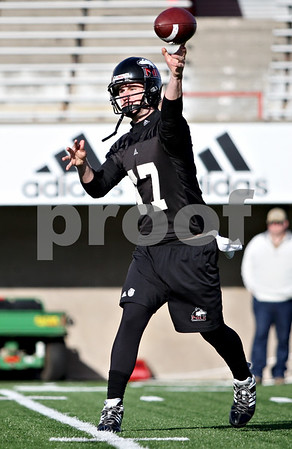 Rob Winner – rwinner@daily-chronicle.com<br /> <br /> A.J. Hill looks to make a completion during NIU football practice on Tuesday March 23, 2010 in DeKalb, Ill.