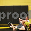 Beck Diefenbach  -  bdiefenbach@daily-chronicle.com<br /> <br /> Austin Culton, top, wrestles with Sycamore teammate Tom Ernster during practice at Sycamore High School on Monday June 28, 2010. Culton and his brother Kyle will be competing in the wrestling nationals in Fargo, North Dakota on July 19.