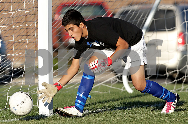 Beck Diefenbach – bdiefenbach@daily-chronicle.com<br /> <br /> Genoa-Kingston's goal keeper Carlos Lechuga tracks a shot during the second half of the game against Rockford Christian at G-K High School in Genoa, Ill., on Thursday Sept. 30, 2010. G-K defeated Rockford Christian 1 to 0.
