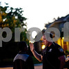 Beck Diefenbach  -  bdiefenbach@daily-chronicle.com<br /> <br /> Officer Weese talks with a boy after a neighbor accused him of throwing rocks at their hourse near HIllcrest Drive in DeKalb, Ill., on Thursday July 1, 2010. Weese didn't arrest the boy, but warned him not to return to that address.
