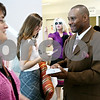 Rob Winner – rwinner@daily-chronicle.com<br /> <br /> Lavell Short, of Chicago, passes out programs to fellow Jehovah's Witnesses during their convention at the Convocation Center in DeKalb, Ill. on Friday June 18, 2010.