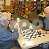Dana Herra dherra@daily-chronicle.com<br /> <br /> Competitors Gary Sargent, left, and Mark Peterson reset the board after completing a game in the DeKalb Chess Club's November chess tournament Sunday.