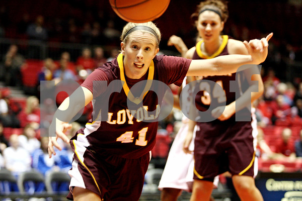 Rob Winner – rwinner@daily-chronicle.com<br /> <br /> Loyola guard Katie Kortekamps chases down a rebound during the first half in DeKalb, Ill. on Tuesday, Dec. 28, 2010.