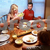 Beck Diefenbach  -  bdiefenbach@daily-chronicle.com<br /> <br /> DeKalb County Liners third baseman Adam Wayman (top right) passes the salad during dinner with his host family, the Millburgs, at their home in Sycamore, Ill., on Monday August 2, 2010. Wayman, of Rider University in New Jersey, has been staying with the Millburg family while he plays for the summer collegiate league team.