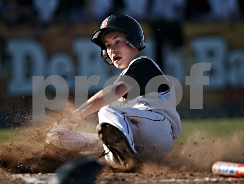 Beck Diefenbach  -  bdiefenbach@daily-chronicle.com<br /> <br /> DeKalb's Luke Hayes (8) slides safe into home during the second inning of the game against Sycamore at DeKalb High School in DeKalb, Ill., on Friday April 9, 2010.