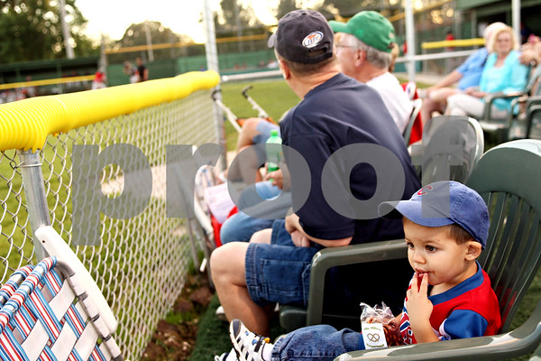 Beck Diefenbach  -  bdiefenbach@daily-chronicle.com<br /> <br /> Vince Stewart, 2, of Sheridan, Ill., enjoys some snacks while watching the DeKalb County Liners home opening game at Founder Field at Sycamore Park in Sycamore, Ill., on Wednesday June 16, 2010.