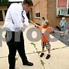 Rob Winner – rwinner@daily-chronicle.com<br /> <br /> Hiawatha Elementary School principal Beau Buchs talks with Logan Marshall, 9, as the first day of school began on Tuesday August 17, 2010 in Kirkland, Ill.