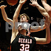 Rob Winner – rwinner@daily-chronicle.com<br /> DeKalb's Jake Jouris (front) is fouled by Sycamore's Joe Strack while taking a shot in the first quarter of the Castle Challenge on Friday January 29, 2010 in DeKalb, Ill.
