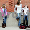 Rob Winner – rwinner@daily-chronicle.com<br /> <br /> (From left to right) Amy Lara, 8, Madison Rausch, 11, and Jenna Lara, 10, gather near the corner of Depot and Washington streets in Somonauk, Ill. before the start of National Walk to School Day on Wednesday Oct. 6, 2010.