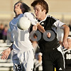 Rob Winner – rwinner@daily-chronicle.com<br /> <br /> Kaneland's Sam Rymarz (left) and Sycamore's Tyler Wallace go for a ball during the second half of their IHSA Class 2A Sycamore Regional semifinal on Wednesday October 20, 2010 in Sycamore, Ill. Kaneland went on to defeat Sycamore, 2-1.
