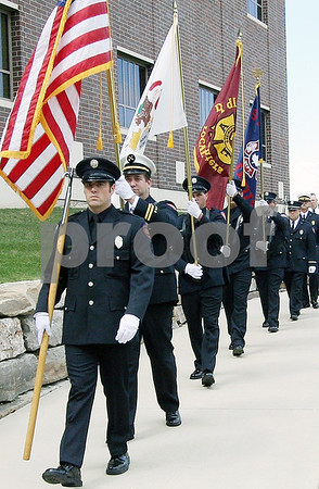 Wendy Kemp - For The Daily Chronicle<br /> Members of the DeKalb and Sycamore Fire Departments walk in the 911 Memorial Service procession in the healing garden of Kishwaukee Hospital on Saturday.<br /> DeKalb 9/11/10