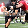Beck Diefenbach - bdiefenbach@daily-chronicle.com<br /> <br /> Northern Illinois quarterback Chandler Harnish during the first practice at Huskie Stadium in DeKalb, Ill., on Thursday Aug. 5, 2010.