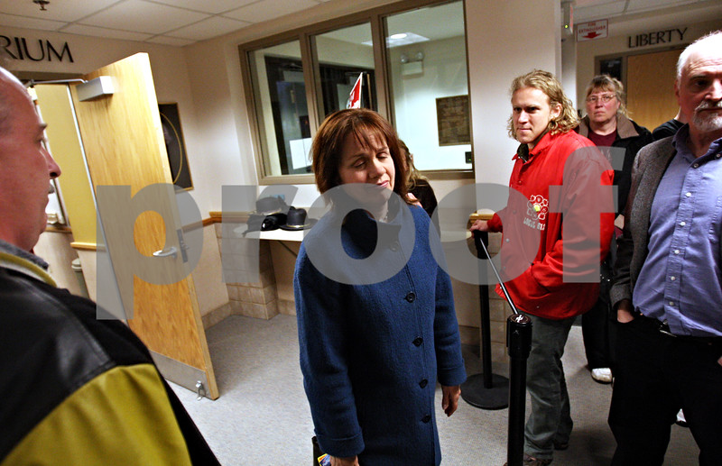 Beck Diefenbach  -  bdiefenbach@daily-chronicle.com<br /> <br /> DeKalb County Board member Julia Fauci (D-DeKalb), center, exits the Gathertorium following the board's approval of the landfill resolution at the DeKalb County Legislative Center in Sycamore, Ill., on Monday May 10, 2010. Fauci voted in favor of approving the resolution.
