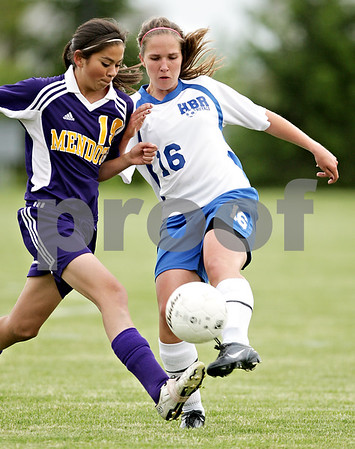 Beck Diefenbach  -  bdiefenbach@daily-chronicle.com<br /> <br /> Mendota Tracy Calderon (19, left) and Hinckley-Big Rock's Hanna VanderMoere(16) battle for the ball during the first half of the game at H-BR in Hinckley, Ill., on Tuesday May 18, 2010.