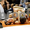 Rob Winner – rwinner@daily-chronicle.com<br /> <br /> DeKalb's Evan Jones (left) looks toward the referee during his 130-pound match against Waubonsie Valley's Andrian Morrison during the Doug Flavin wrestling tournament at DeKalb on Thursday night. Jones won the match.