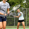 Beck Diefenbach - bdiefenbach@daily-chronicle.com<br /> <br /> Sycamore's Mary Stang (right) returns the ball during doubles practice with her teammate Emily Eggers (left) at Sycamore High School in Sycamore, Ill., on Tuesday Aug. 17, 2010.