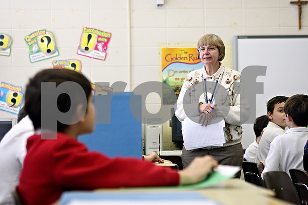 Rob Winner – rwinner@daily-chronicle.com<br /> Third grade teacher Carol Schuenemann, of St. Mary Catholic School in DeKalb, Ill., gives her students a spelling test on Tuesday January 12, 2010.