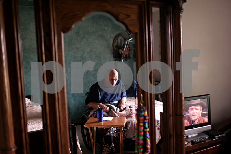 Beck Diefenbach  -  bdiefenbach@daily-chronicle.com<br /> <br /> Bill Chesnutt, a resident of Jabez Elder Care in Somonauk, Ill., watches the television program Bonanza on Monday July 12, 2010.