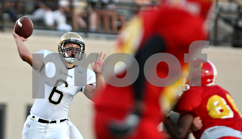 Rob Winner - rwinner@daily-chronicle.com<br /> <br /> Quarterback Ryan Bartels looks to pass during the first quarter of their game against North Lawndale at Lane Stadium in Chicago, Ill. on Saturday August 28, 2010.