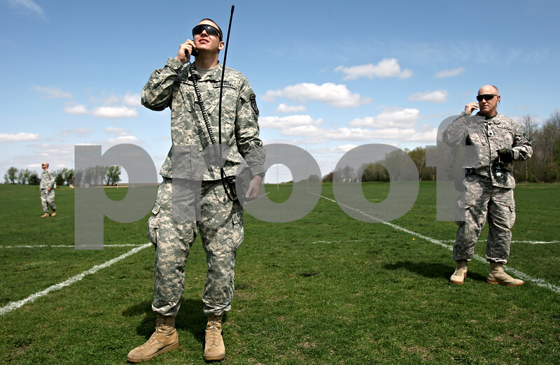 Rob Winner – rwinner@daily-chronicle.com<br /> <br /> Cadet Stefan Goray, a senior ROTC student at Northern Illinois University, uses a radio to listen for three incoming Black Hawk helicopters in a lacrosse field just north of the Convocation Center in DeKalb, Ill. on Friday April 16, 2010.
