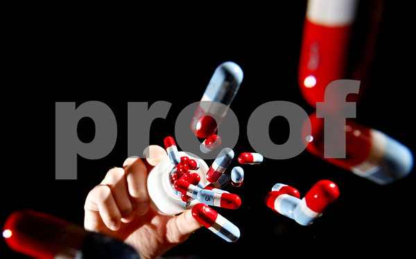 Photo Illustration by Rob Winner – rwinner@daily-chronicle.com and Kyle Bursaw – kbursaw@daily-chronicle.com<br /> <br /> Disposing pills for Nicole's story on Tuesday